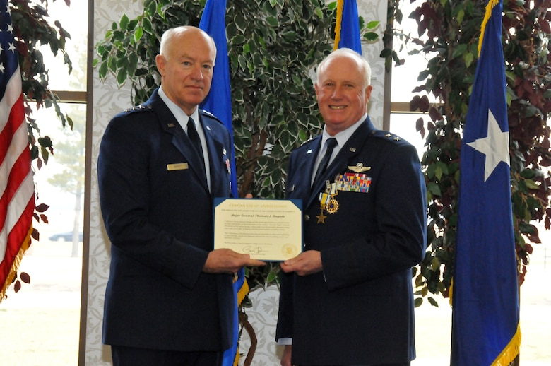 Lt. Gen. Harry M. Wyatt III (left) presents a Certificate of Appreciation to Maj. Gen. Thomas J. Haynes, Air National Guard Assistant to the Commander, Air Mobility Command, during Maj. Gen. Haynes' retirement ceremony at Scott AFB, Ill., on Jan. 27, 2012. The letter is signed by President Barack Obama extending the thanks of a grateful nation for his honorable service.