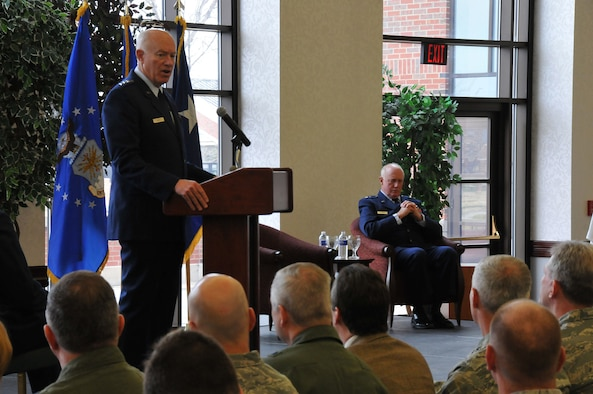 Lt. Gen. Harry M. Wyatt III (left) officiates over the retirement ceremony of Maj. Gen. Thomas J. Haynes (seated), Air National Guard Assistant to the Commander, Air Mobility Command, at Scott Air Force Base, Ill., on Jan. 27, 2012. Haynes retires with more than 40 years of service.