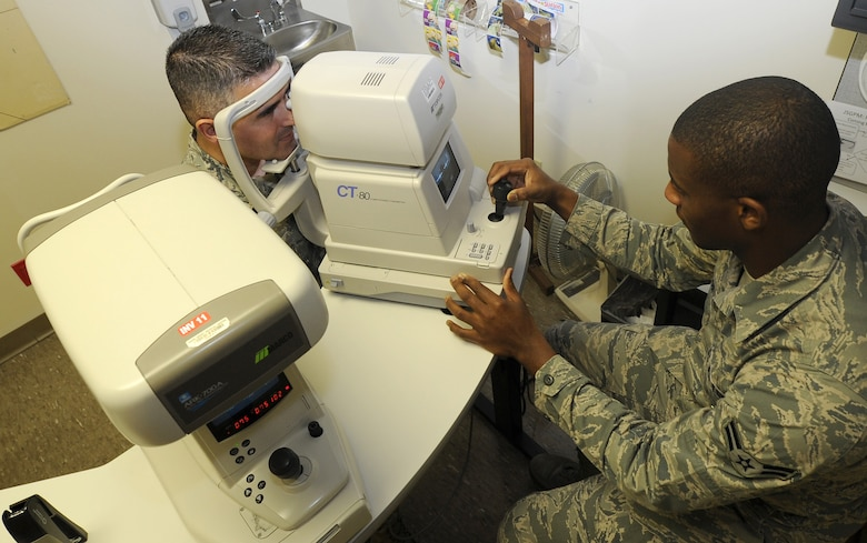 Airman 1st Class Ikeem Taylor, ophthalmic technician, performs a noncontact tonometry test Jan. 26 at the David Grant USAF Medical Center Optometry Clinic. This procedure is an important test in the evaluation of patients at risk from glaucoma. (U.S. Air Force photo/ Staff Sgt. Liliana Moreno)