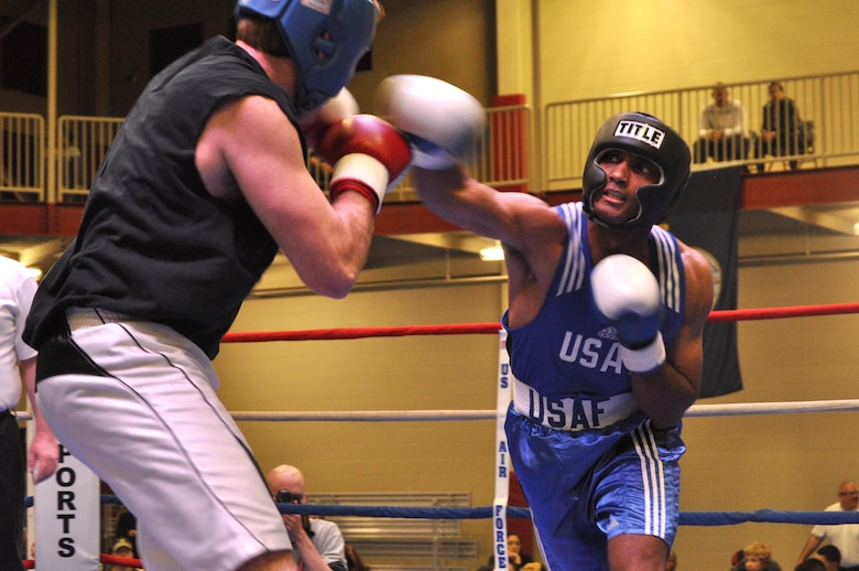 Irby Burnett, senior airman from the 60th Maintenance Squadron, Travis Air Force Base, Calif., lands a punch on Jesse Richardson during the Air Force Box-Off Tournament at the METC Campus Fitness Center Saturday. (U.S. Air Force photo/ Deyanira Romo Russell)