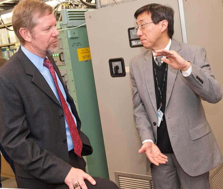 Scott Hardiman (left), Space and Nuclear Networks Division acting chief, speaks to Chao-Min King, General Dynamics Defense Injection/Reception Emergency Action Message Command and Control Terminal (DIRECT) program manager, at the contractor's facility in Needham, Mass., Jan. 9. The Electronic Systems Center recently transitioned the DIRECT program to Warner Robins Air Logistics Center, Ga., for continuing sustainment. (Photo by Steve Mason, General Dynamics C4 Systems)