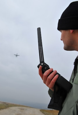 BAUMHOLDER, Germany – U.S. Air Force 1st Lt. Bob Carpenter, 81st Fighter Squadron pilot, uses a combat survivor evader locater radio to communicate with U.S. Air Force A-10 Thunderbolt II pilots during a U.S. Army and Air Force close air support and combat search and rescue training exercise at the Baumholder Major Training Area here Jan. 26. He relayed this information as the A-10s practiced CAS in an enemy threat scenario. The goal of this training is to develop tactics, techniques and procedures between the military branches to enhance interoperability. (U.S. Air Force photo/ Senior Airman Natasha Stannard)