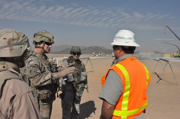 AFGHANISTNA — Air Force Col. Benjamin Wham, U.S. Army Corps of Engineers Afghanistan Engineer district-commander(second from left), and Mike Fellenz (center), the Farah Resident Office project engineer, discuss the status of construction at Camp Sayar, in Farah province Nov. 30, 2011.