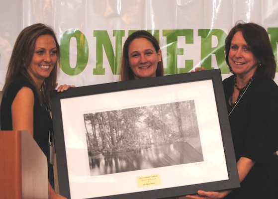 FLORIDA — Jo-Ellen Darcy, Assistant Secretary of the Army for Civil Works (right), received the James D. Webb Award at the Everglades Coalition Conference Jan. 7, 2012. Julie Hill-Gabriel (center), State Everglades Coalition Co-Chair, presented the award along with Dawn Shirreffs (left), National Everglades Coalition Co-Chair.