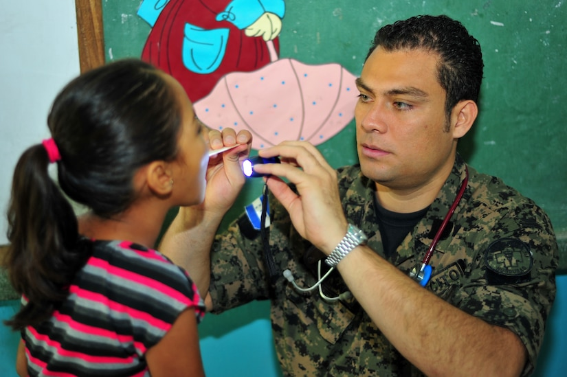 OLANCHO, Honduras - Dr. Jeffery Arevalo, a Honduran Military Hospital Emergency Room physician, exams a Cerro Del Vigia child from the Olancho District during the second day of the Joint Medical Readiness Training Exercise here. The exercise included members from the Honduran Ministry of Health, the Honduran military and Joint Task Force-Bravo, Soto Cano Air Base, Honduras, Jan. 30 here. (Air Force photo/Staff Sgt. Bryan Franks)