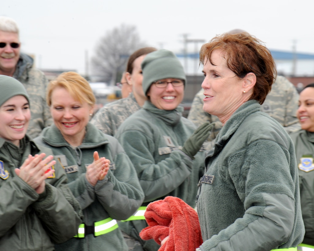 Col. Jacqueline Nave, right, is congratulated after her final flight by her fellow Tennessee Air National Guardsmen. (Photo by: Tech. Sgt. Robin Olsen, Tenn. National Guard Joint Force Headquarters Public Affairs.)