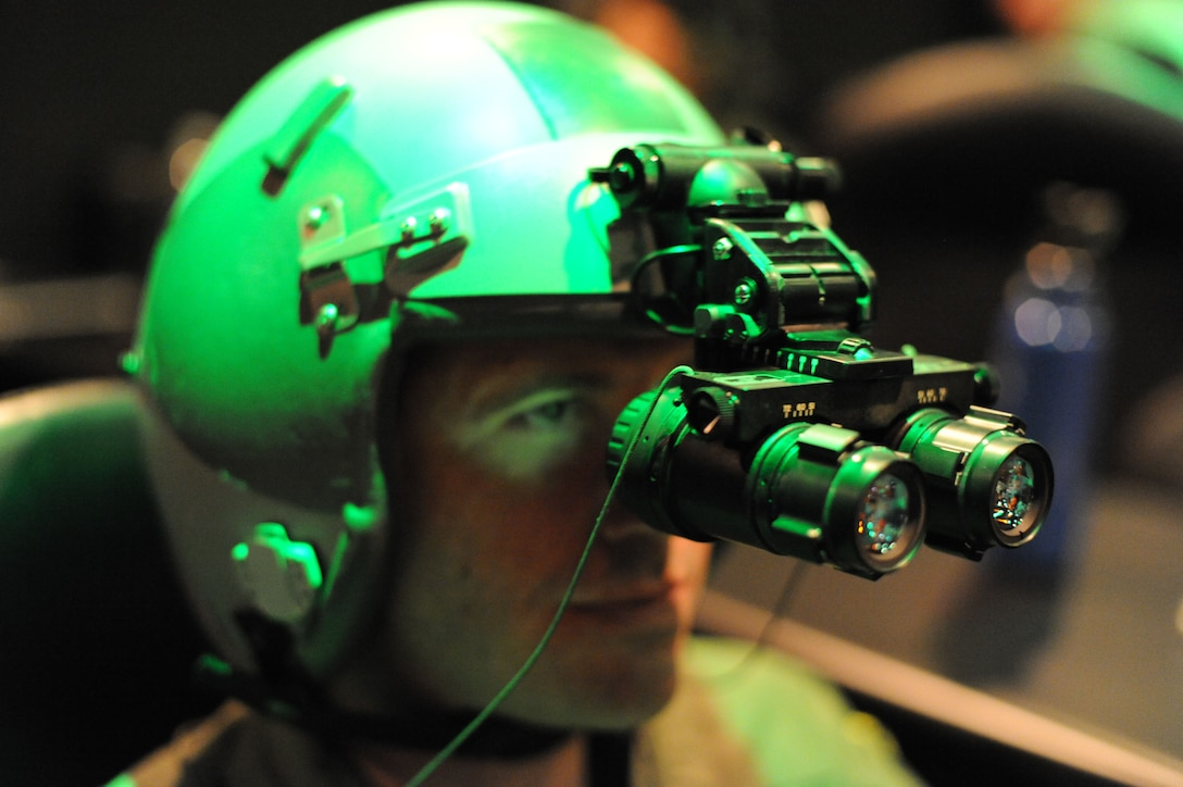 2nd Lt. Michael Vastola, 359th Aerospace Medicine Squadron OIC of Logistics Element,  aligns his night vision goggles during a NVG Academic Instructors Course held at the Aerospace Physiology building on Joint Base San Antonio-Randolph Jan. 25. (U.S. Air Force photo/Rich McFadden) (released)