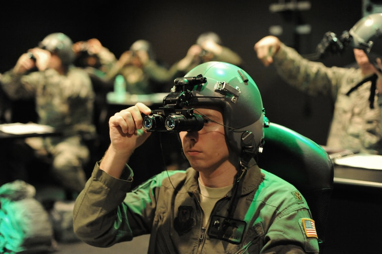 Major Kris Ostrowski, 27th Special Operations Support Squadron aerospace and operational physiology chief,  aligns his night vision goggles during a NVG Academic Instructors Course held at the Aerospace Physiology building on Joint Base San Antonio-Randolph Jan. 25. (U.S. Air Force photo/Rich McFadden) (released)