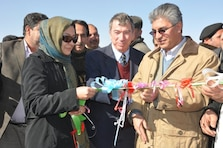 AFGHANISTAN — Dr. Suraya Dalil (left), acting Afghan Minister of Health, Brad Hanson, U.S. Department of State Representative, Provincial Reconstruction Team and Daud Shah Saba, Governor of Herat Province cut the ribbon at the Shindand Hospital groundbreaking ceremony, Jan 28, 2012.