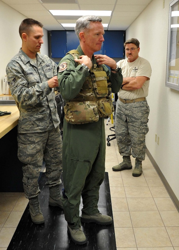 Airman Scott Garner with the 943rd Operations Support Flight fits Brig. Gen. William Binger's flight gear prior to the general's flight in an HH-60 Pave Hawk helicopter. The general visited the 943rd Rescue Group to learn about its combat-search-and-rescue mission and visit with Reserve Airmen stationed at Davis Monthan Air Force Base, Ariz. (U.S. Air Force Photo/ Master Sgt. Luke Johnson)