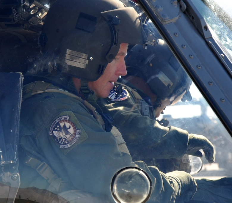 Brig. Gen. William Binger, 10th Air Force commander, performs pre-flight checks prior to his familiarization flight in an HH-60 Pave Hawk helicopter. General Binger visited the 943rd Rescue Group at Davis-Monthan Air Force Base, Ariz., to learn about the combat-search-and-rescue mission and the Air Force Reserve units based there. (U.S. Air Force Photo/ Master Sgt. Luke Johnson)