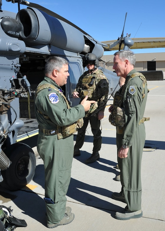 Lt. Col. Jeffery Peterson, Air National Guard and Air Force Reserve Test Center, explains the flight characteristics of the HH-60 Pave Hawk helicopter prior to Brig.