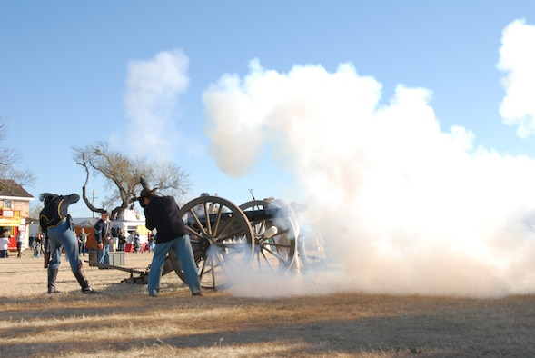 "SAN ANGELO, Texas-- Re-enactors from Fort Concho, a historical Army fort dating before the Civil War, fire a cannon from that time period. The unusual ""Buffalo Soldiers"" nickname was given to the black troops of the frontier west by the Northern Plains Indians after the Civil War, some of whom were stationed at this site. (Courtesy photo)"