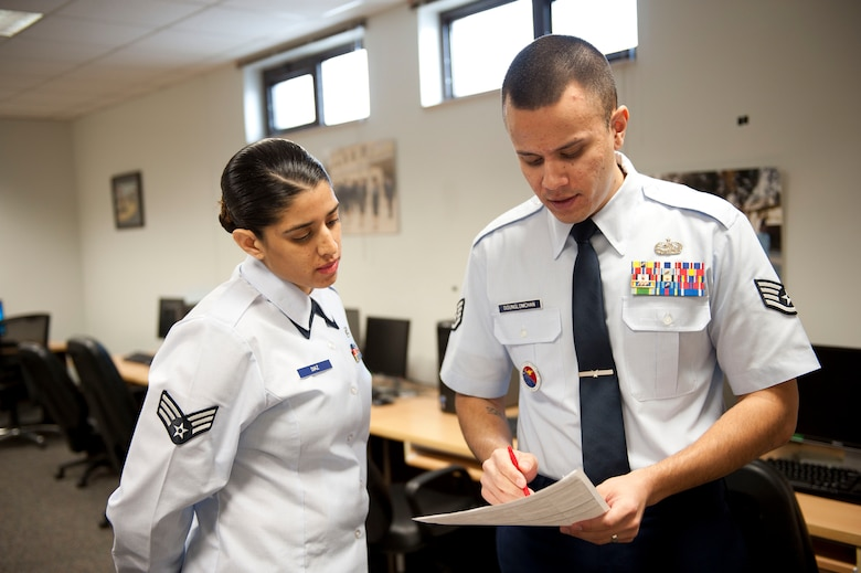 Staff Sgt. Kitsana Dounglomchan, airman leadership school instructor, gives feedback to Senior Airman Irna Diaz, 728th Air Mobility Squadron, after her presentation Jan. 30, 2012, at Incirlik Air Base, Turkey. ALS is a five-week course for senior airmen, and sometimes staff sergeants, to learn to be effective frontline supervisors.(U.S. Air Force photo by Senior Airman Clayton Lenhardt/Released)