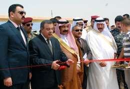 IRAQ -- Government officials and representatives from Iraq's Ministry of Municipalities and Public Works cut the ribbon at a ceremony celebrating the facility's completion.