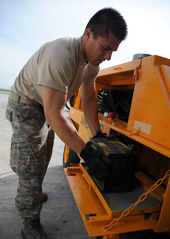 Staff Sgt. Peter Salinas, 571st Mobility Support Advisory Squadron aerial transportation air advisor, checks the battery connections on a generator before weighing and loading it onto an aircraft during an Air Mobility Command Building Partner Capacity mission at General Alberto Pauwels Rodriguez Air Base in Barranquilla, Colombia, June 27.  (U.S. Air Force photo by Tech. Sgt. Lesley Waters)