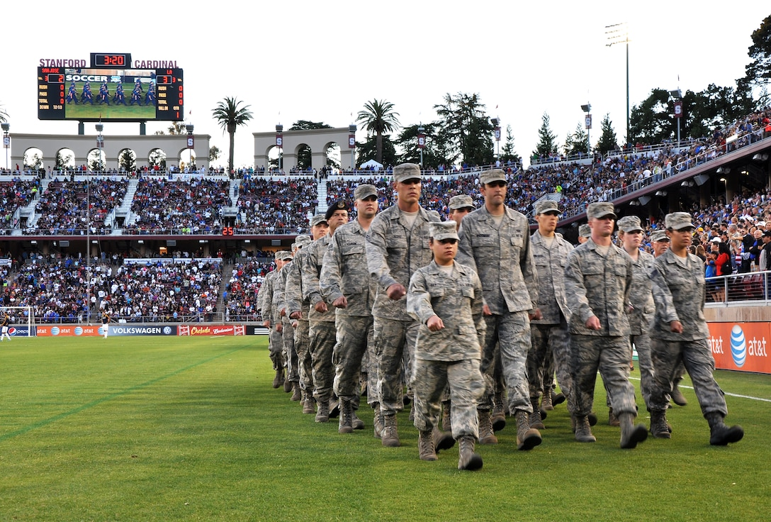 A formation of U.S. Air Force Airmen march during the halftime show of the L.A. Galaxy versus San Jose Earthquakes soccer game at Stanford Stadium, Stanford, Calif., June 30, 2012. Every branch of the U.S. military was represented with a formation. (U.S. Air Force photo by Staff Sgt. Robert M. Trujillo/Released)