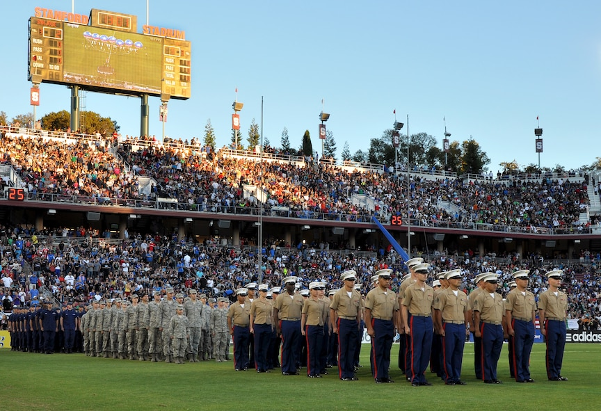 U.S. servicemembers line up in formation during the halftime show of the L.A. Galaxy versus San Jose Earthquakes soccer game at Stanford Stadium, Stanford, Calif., June 30, 2012. More than 50,000 soccer fans attended the game that honored the U.S. military during the halftime show. (U.S. Air Force photo by Staff Sgt. Robert M. Trujillo/Released)