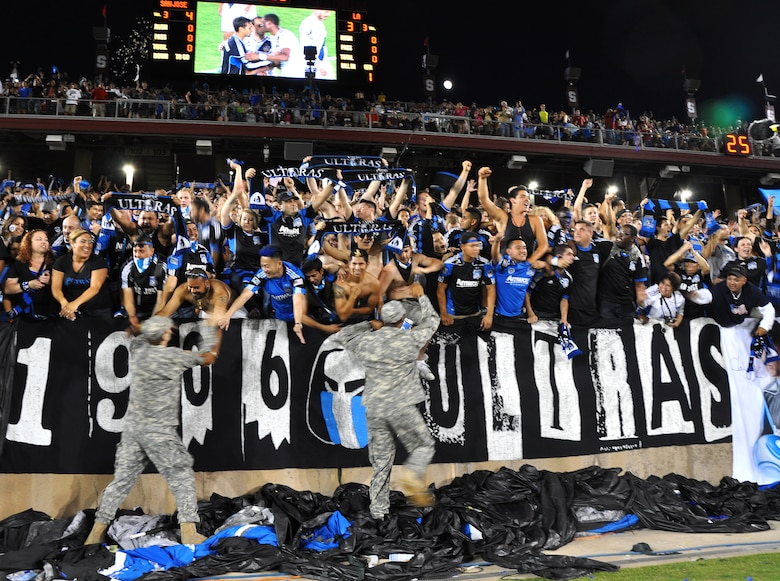 U.S. servicemembers celebrate with San Jose Earthquakes fans after the team's 4-3 win over the L.A. Galaxy at Stanford Stadium, Stanford, Calif., June 30, 2012. The military appreciation game featured a halftime marching performance from every service. (U.S. Air Force photo by Staff Sgt. Robert M. Trujillo/Released)