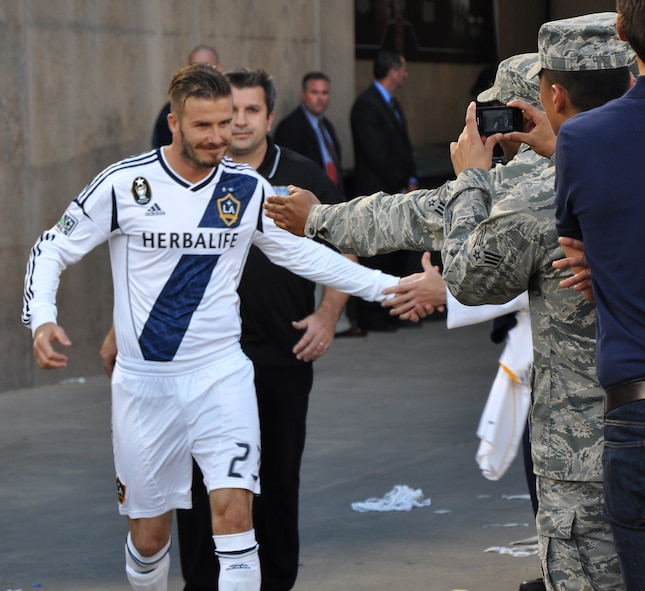 David Beckham, L.A. Galaxy midfielder, shakes the hands of U.S. servicemembers during the start of the second half of the L.A. Galaxy versus San Jose Earthquakes soccer game at Stanford Stadium, Stanford, Calif., June 30, 2012. More than 300 servicemembers participated in a halftime show that honored America's troops. (U.S. Air Force photo by Staff Sgt. Robert M. Trujillo/Released)