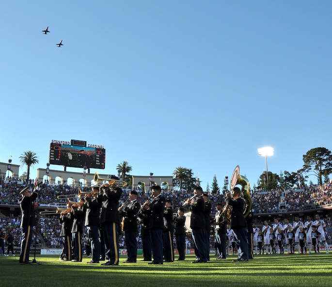 The 300th U.S. Army Reserve Band plays the national anthem as U.S. Air Force T-38 trainer jets fly-over the opening ceremonies of the L.A. Galaxy versus San Jose Earthquakes game at Stanford Stadium, Stanford, Calif., June 30, 2012. The Air Force jets flew from Beale Air Force Base, Calif., to provide the fly-over. (U.S. Air Force photo by Staff Sgt. Robert M. Trujillo/Released)