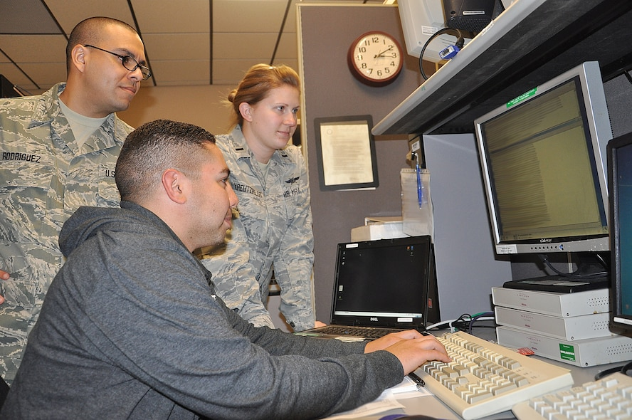 JOINT-BASE SAN ANTONIO, Texas -- Members of the 92nd Information Operations Squadron work as a team to study mission data. Correct analysis of the information is critical to discovering and targeting threats posed to Air Force networks. 92nd IOS operators are able to combat the ever-present threat of attack on vital networks by dissecting codes, scripts and security configurations. (U.S. Air Force photo by Tech. Sgt. Scott McNabb)