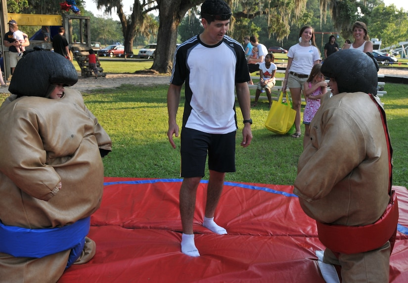 Michael Felton Jr. (right) stares down his opponent and friend Chase Iseman (left) before a sumo suit battle June 29 during the 2012 Freedom Fest at Marrington Plantation at Joint Base Charleston – Weapons Station. Felton is the son of retired Senior Chief Michael Felton Sr. Nearly 1,500 Sailors, Airmen, civilians and their families attended the fest which included food, drinks, festival rides, music and fireworks. (U.S. Air Force photo/Airman 1st Class Jared Trimarchi)