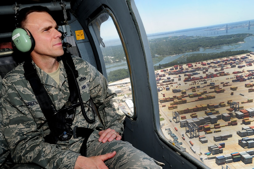 Brig. Gen. Timothy Green, Director of Installations and Mission Support, Headquarters Air Mobility Command, Scott Air Force Base, Ill., looks out the window of a UH-60 Black Hawk while flying over Charleston, S.C., June 27, 2012.  Green and Maj. Gen. Timothy Byers, the Civil Engineer, Headquarters Air Force, Washington D.C., were given an aerial tour of Joint Base Charleston - Air Base and Weapons Station, Short Stay Naval recreation area and North Auxiliary Air Field.  Byers and Green were accompanied by members of JB Charleston leadership.  (U.S. Air Force/Staff Sgt. Nicole Mickle)