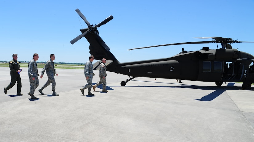 Army 1st Lt. Josh Puette, UH-60 Black Hawk pilot, 1st Battalion, 151st Aviation Regiment, 59th Aviation Troop Command, Columbia, S.C., escorts Maj. Gen. Timothy Byers, the Civil Engineer, Headquarters Air Force, Washington D.C., Brig. Gen. Timothy Green, Director of Installations and Mission Support, Headquarters Air Mobility Command, Scott Air Force Base, Ill., Col. Richard McComb, Joint Base Charleston commander and Col. Al Miller, 437th Airlift Wing vice commander, to the Black Hawk at the Atlantic Aviation flight-line, North Charleston, S.C., June 27, 2012.  Byers and Green were given an aerial tour of Joint Base Charleston - Air Base and Weapons Station, Short Stay Naval recreation area and North Auxiliary Air Field.  Byers and Green were accompanied by members of JB Charleston leadership.  (U.S. Air Force/Staff Sgt. Nicole Mickle)