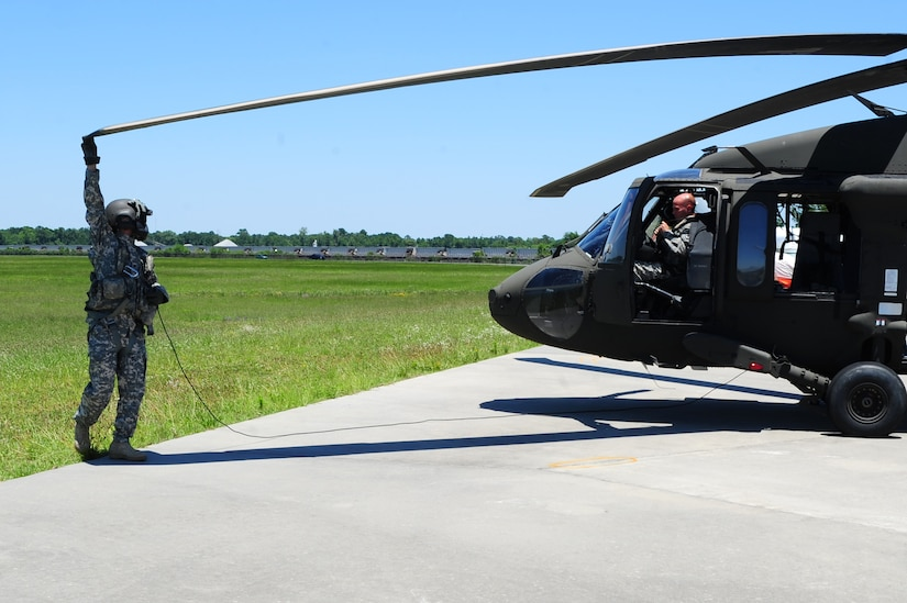 Army Spc. Kenneth Burton, a UH-60 Blackhawk crew chief, 1st Battalion, 151st Aviation Regiment, 59th Aviation Troop Command, Columbia, S.C., performs a maintenance check on a UH-60 Black Hawk before take-off at Atlantic Aviation flight-line, North Charleston, S.C., June 27, 2012.  Maj. Gen. Timothy Byers, the Civil Engineer, Headquarters Air Force, Washington D.C., and Brig. Gen. Timothy Green, Director of Installations and Mission Support, Headquarters Air Mobility Command, Scott Air Force Base, Ill., were given an aerial tour of Joint Base Charleston - Air Base and Weapons Station, Short Stay Naval recreation area and North Auxiliary Air Field.  Byers and Green were accompanied by members of JB Charleston leadership.  (U.S. Air Force/Staff Sgt. Nicole Mickle)