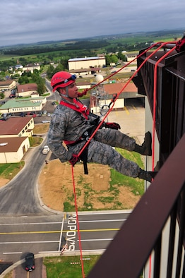 SPANGDAHLEM AIR BASE, Germany – Airman 1st Class Tyler Clemons, 52nd Civil Engineer Squadron firefighter, rappels down the control tower during training here June 29. Firefighters from the 52nd CES complete rappelling training so they can be rescue certified to perform rope and high-angle rescue techniques. The firefighters train annually to ensure the force maintains the highest level of proficiency and readiness for rapid rescue attempts in demanding situations. (U.S. Air Force photo by Airman 1st Class Dillon Davis/Released)