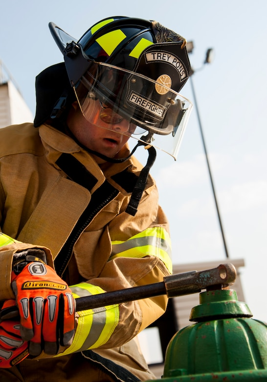 """GOODFELLOW AIR FORCE BASE, Texas-- Maxwell """"Trey"""" Pons III, Honorary Air Force firefighter, opens a fire hydrant at the Louis F. Garland DOD Fire Academy June 28. Pons, who is autistic, sight impaired and hearing-impaired, accomplished his dream to become a firefighter by going through each training block in a day at the Fire Academy. (U.S. Air Force photo/Airman 1st Class Michael Smith)"""