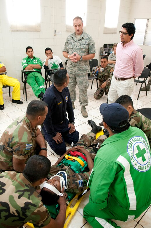 N.H. Air National Guard Tech. Sgt. Shawn Theberge exchanges his experiences in extracting a patient who was injured in a vehicle incident during a subject matter expert exchange with members of the Salvadoran Army and other local civil authorities June 27, 2012. Members of the 157th Medical Group are in El Salvador for the exchange as part of the New Hampshire and El Salvador state partnership program. (N.H. National Guard photo by Tech. Sgt. Mark Wyatt/RELEASED)