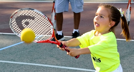 Four year-old Elsie Dabney swings at a tennis ball during a drill as part of the new tennis program being offered by the Child Youth and School Services office, June 28, 2012 at Fort Eustis, Va. The new program will be offered twice a year to children ages 10 and under. (U.S. Air Force photo by Senior Airman Wesley Farnsworth/Released)