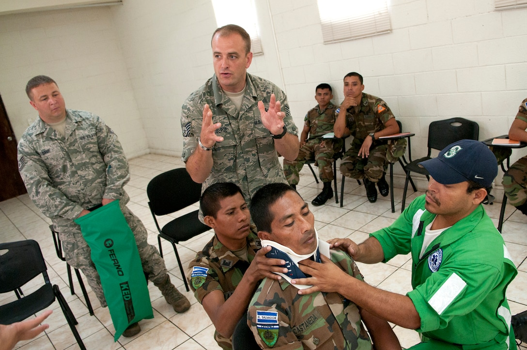 Nelson Alexander Rivas Bueno (right) applies a neck brace as Tech. Sgt. SHawn Theberge instructs a scenario of extracting a patient from a vehicle during a subject matter expert exchange with members of the Salvadoran Army and other local civil authorities as Tech. Sgt.Michael Dame looks on June 27, 2012. Members of the 157th Medical Group are in El Salvador for the exchange as part of the New Hampshire and El Salvador state partnership program. (N.H. National Guard photo by Tech. Sgt. Mark Wyatt/RELEASED)