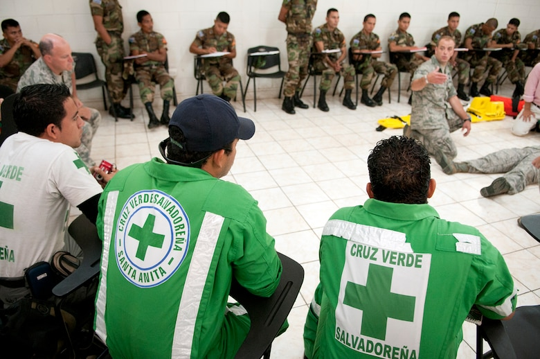 Members of Green Cross, a volunteer civil organization in El Salvador, listen as Tech. Sgt. Shawn Theberge offers his expereinces as a first responder during a subject matter expert exchange with members of the Salvadoran Army and other local civil authorities June 27, 2012. Members of the 157th Medical Group are in El Salvador for the exchange as part of the New Hampshire and El Salvador state partnership program. (N.H. National Guard photo by Tech. Sgt. Mark Wyatt/RELEASED)