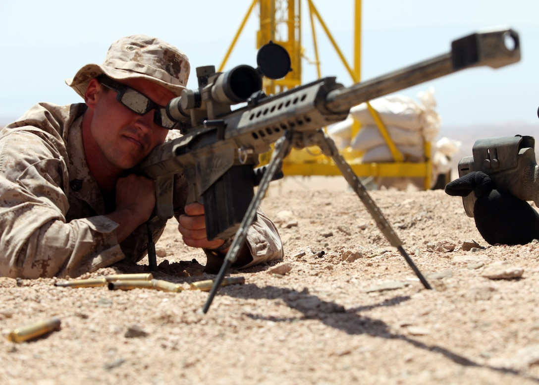 Staff Sgt. Zachary Burghart, a Maritime Raid Force team leader, 24th Marine Expeditionary Unit, verifies scope settings on an M107 .50 cal Special Application Scoped Rifle, or SASR, during bilateral live-fire training with members of the Jordanian 77th Marine Reconnaissance Battalion here, May 8, 2012. The bilateral training is part of Exercise Eager Lion 12, taking place throughout the month of May and designed to strengthen military-to-military relationships of over 19 participating partner nations. This is the second major exercise for the 24th MEU who, along with the Iwo Jima Amphibious Ready Group, is currently deployed as a theater security and crisis response force.