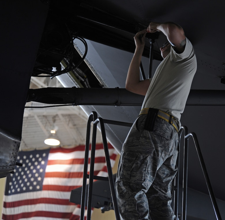 Airman 1st Class Michael Romanyak, 2nd Maintenance Squadron, checks a discrepancy on a B-52H Stratofortress in the Phase Hangar on Barksdale Air Force Base, La., July 2. Before a B-52 can fly, it has to have all of its discrepancies cleared. Romanyak enjoys riding dirt bikes and competing in local Motocross competitions in his spare time. According to Romanyak the activity helps him come back to work refreshed and ready to go. (U.S. Air Force photo/Airman 1st Class Micaiah Anthony)(RELEASED)