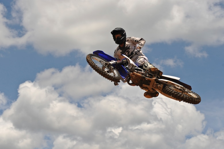 A local dirt bike enthusiast soars through the air over a dirt track in Mansfield, La., July 1. A few Barksdale Air Force Base Airmen enjoy riding and racing dirt bikes to unwind after a long work week. In order to ride and race dirt bikes, Airmen must complete the motorcycle safety course at Barksdale Air Force Base along with having a high-risk activity briefing from their commander. (U.S. Air Force photo/Airman 1st Class Micaiah Anthony)(RELEASED)