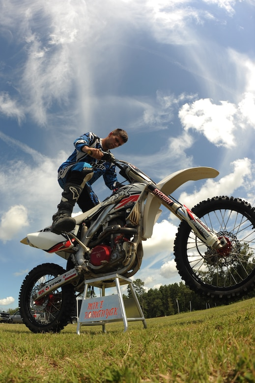Airman 1st Class Michael Romanyak, 2nd Maintenance Squadron, starts his dirt bike at a track in Mansfield, La., July 1. Romanyak enjoys riding and racing dirt bikes on the weekend to unwind from a long week at work. (U.S. Air Force photo/Airman 1st Class Micaiah Anthony)(RELEASED)