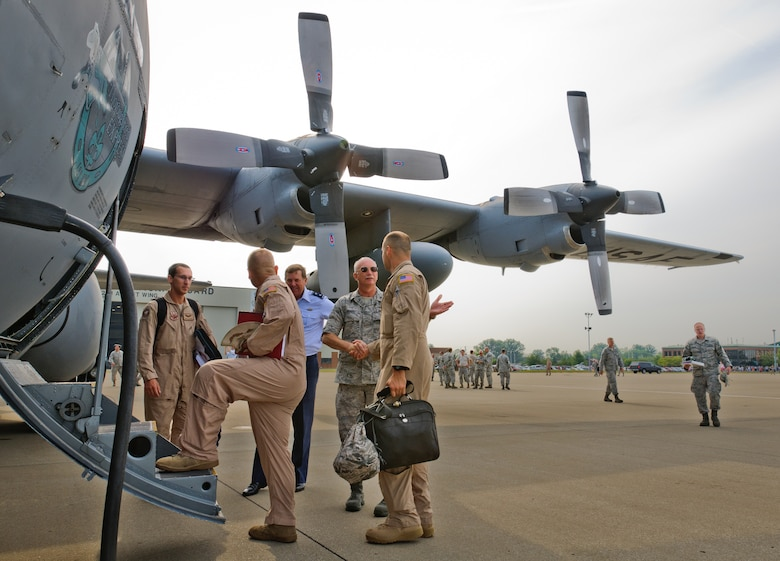 Kentucky's adjutant general, Maj. Gen. Edward W. Tonini, and Brig. Gen. Mark Kraus, Kentucky's assistant adjutant general for Air, shake hands with Airmen from the 123rd Airlift Wing as they board a C-130 at the Kentucky Air National Guard Base in Louisville, Ky., prior to a deployment to the Persian Gulf region on July 2, 2012. The wing deployed 70 Airmen and two C-130 aircraft in support of operations Enduring Freedom and New Dawn. (U.S. Air Force photo by Master Sgt. Phil Speck)