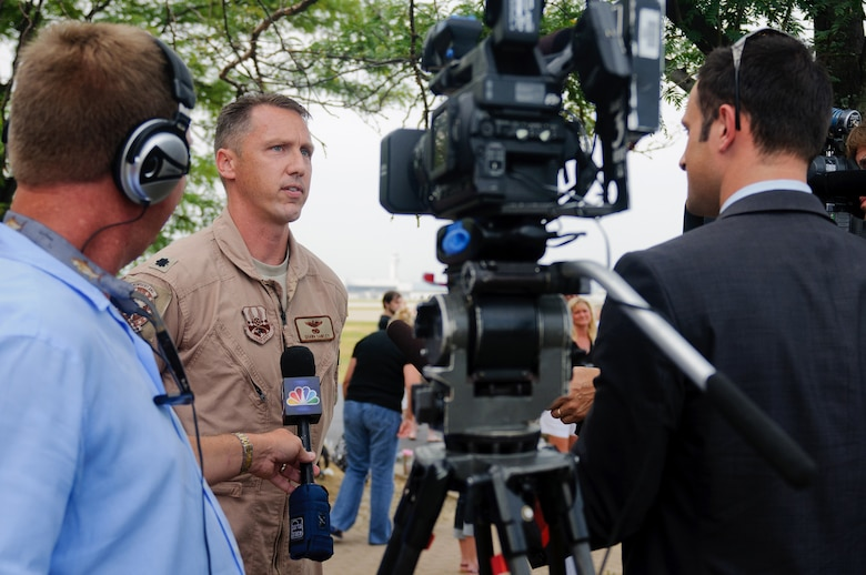 Lt. Col. Shawn Dawley, commander of the 165th Airlift Squadron, talks to local media at the Kentucky Air National Guard Base in Louisville, Ky., on July 2, 2012, prior to takeoff for a deployment. The 123rd Airlift Wing deployed 70 Airmen and two C-130 aircraft to the Persian Gulf region in support of operations Enduring Freedom and New Dawn. The deploying Airmen will operate from an undisclosed air base in Southwest Asia, flying troops and cargo across the U.S. Central Command Area of Responsibility as part of the 386th Air Expeditionary Wing. (U.S. Air Force photo by Master Sgt. Phil Speck)