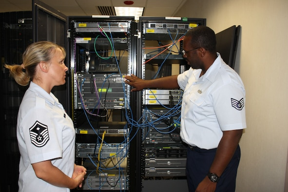 (right) SSgt Courtney Rawls, AFNIC/NVT, provides MSgt Anna Keck, AFNIC/CCF, a brief overview of what his job entails as a Supervisor of AFNIC's Technology and Interoperability Facility. The TIF enables the AFNIC to develop, validate and deliver communications and computer systems, training, techniques and procedures that achieve needed war fighter capabilities.