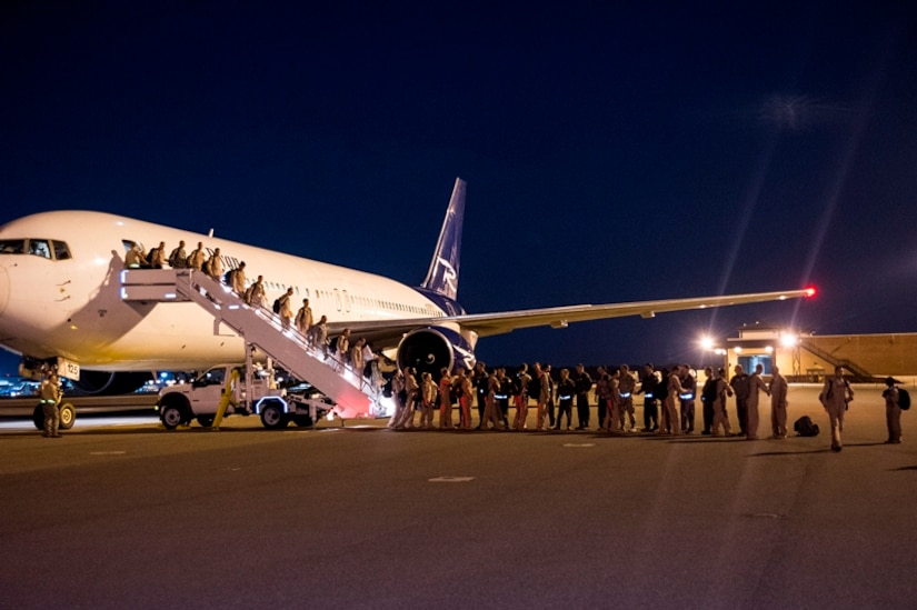 Airmen of the 16th Airlift Squadron, 437th Airlift Wing, return home from a deployment at Joint Base Charleston - Air Base, S.C., July 2, 2012. While deployed, the 16th AS served under the 816th Expeditionary Airlift Squadron, supporting combat operations in the U.S. Central Command area of responsibility. (U.S. Air Force photo by Airman 1st Class George Goslin/Released)