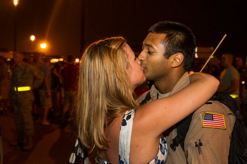 1st Lt. Imran Khan, 16th Airlift Squadron, 437th Airlift Wing pilot, kisses his wife Grace after returning from a deployment at Joint Base Charleston - Air Base, S.C., July 2, 2012. While deployed, the 16th AS served under the 816th Expeditionary Airlift Squadron, supporting combat operations in the U.S. Central Command area of responsibility. (U.S. Air Force photo by Airman 1st Class George Goslin/Released)
