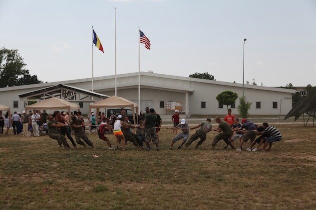 Marines of Black Sea Rotational Force 12 and local Romanian children play tug-of-war during an Independence Day celebration on Mihail Kogalniceanu, Romania July 4. Special guests of the event included approximately 200 local orphans from six different homes in the Constanta, Romania area. Black Sea Rotational Force 12 is a Special-Purpose Marine Air-Ground Task Force with crisis response capabilities deployed to the region to enhance interoperability and promote regional stability.