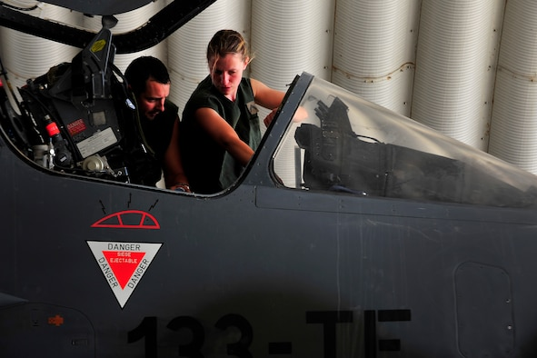 Members of the French Air Force, Detachment 3/3, perform maintenance inspections and checklists on a Mirage 2000-D before a combat mission at Kandahar Airfield, Afghanistan, June 15, 2012. The French AF has been a coalition partner with the U.S. during Operation Enduring Freedom (OEF) and perform air to ground close air support missions for friendly ground forces. (U.S. Air Force photo/Staff Sgt. Clay Lancaster)