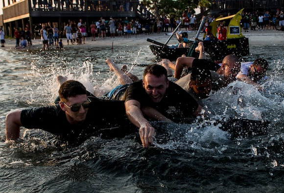 U.S. Air Force airmen from the 1st Special Operations Logistics Readiness Squadron try to propel their cardboard boat during the 24th Annual Cardboard Boat Regatta at the marina on Hurlburt Field, Fla., June 29, 2012. Participants had to maneuver their boats down to a buoy and then come back to shore. (U.S. Air Force photo / Airman 1st Class Christopher Williams) (RELEASED)