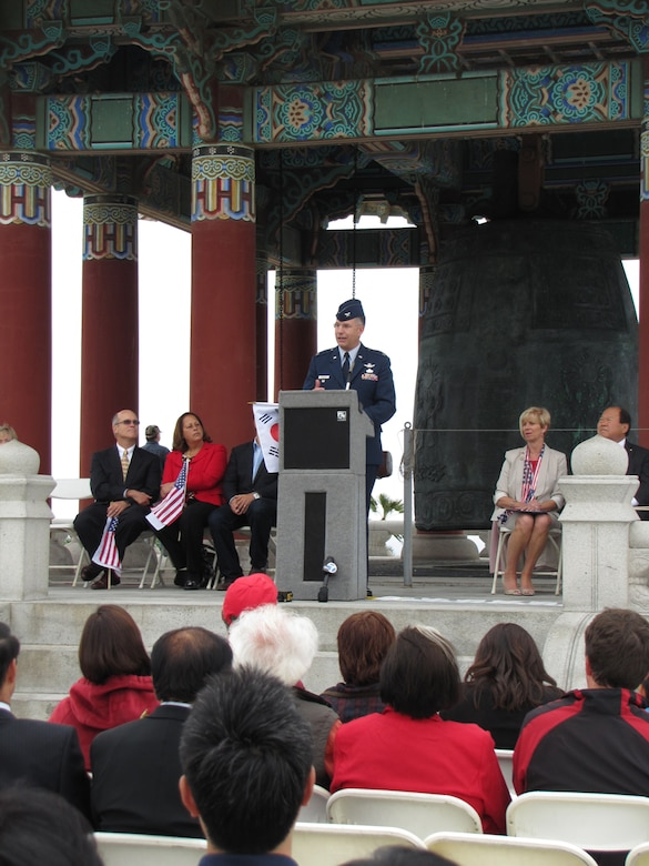 Colonel Arnold Streland, SMC's Space Superiority Systems director,  welcomes dignitaries and guests at the 53rd Annual Korean Bell 4th of July Celebration in San Pedro, Calif.  The bell was a gift to the United States from the Republic of Korea to mark the U.S. Bicentennial in 1976. (Photo by Lynn Kirby)