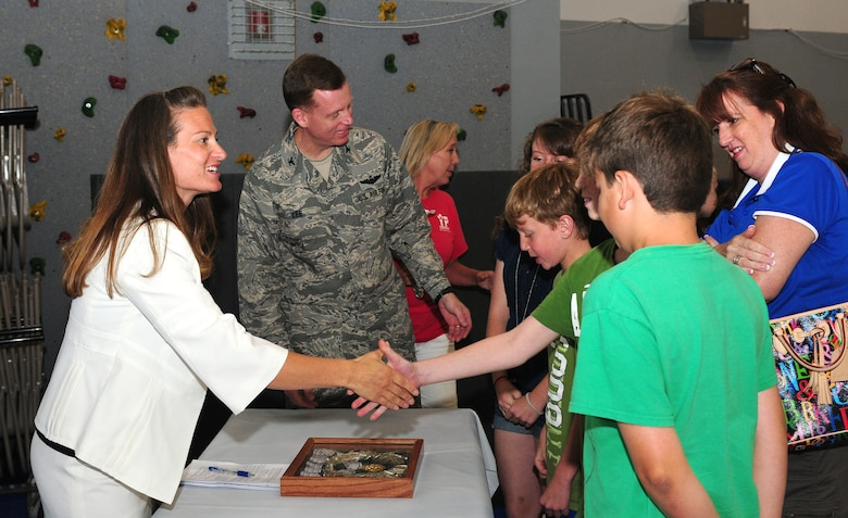 Jennifer Kelchner, a Paralympics gold medalist speaks to Col. Douglas Lee, 9th Reconnaissance Wing vice commander, and his family at the Youth Center at Beale Air Force Base, Calif., June 27, 2012. Kelchner kicked off Beale's Olympic Day with her story of winning a gold medal at the 1998 Winter Olympics in Japan. (U.S. Air Force photo by Senior Airman Allen Pollard)